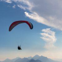 blue sky, parachute and human silhouette. adventure